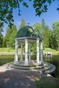 Rotunda in the park near pond - stock photo