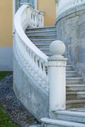 Outdoor old style spiral stairs with column and ornate railing Stock Photos
