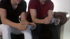 Teenagers playing a video game. Stock Footage