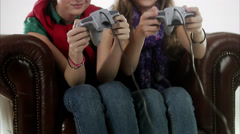 Teenage girls playing a video game. Stock Footage