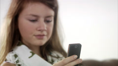 Teenage girl using her mobile phone. Stock Footage