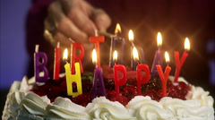 Burning candles on a birthday cake, Sweden. Stock Footage