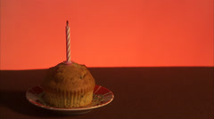 Muffin with a burning candle, Sweden. Stock Footage