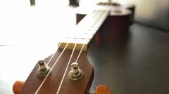 Classic ukulele on leather sofa Stock Footage