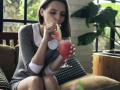 Young businesswoman gets drink from waitress in cafe NTSC Stock Footage
