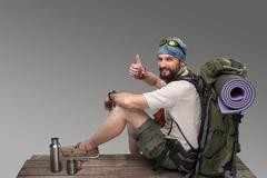 Portrait of a smiling male fully equipped tourist - stock photo