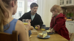 Family with a small child having breakfast, Sweden. Stock Footage