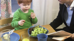 Father and son by a kitchen table, Sweden. Stock Footage