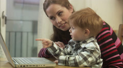 Mother and small son using a laptop, Sweden. Stock Footage