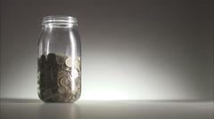 Money in a jar. Stock Footage