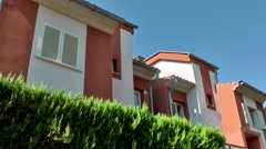 Spain Mallorca Island Cala Blava 027 red and white colored row houses Stock Footage