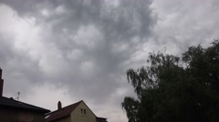 4k Thunderstorm with lighning over backstreet city roofs Stock Footage