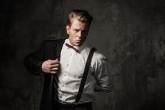 Tough sharp dressed man in black suit - stock photo