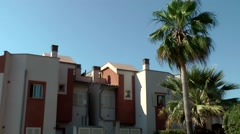 Spain Mallorca Island Cala Blava 035 red and white colored spanish row house Stock Footage