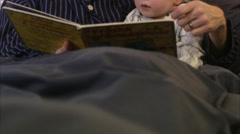 Father reading a book with his son, Sweden. Stock Footage