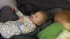 Siblings in bed, Sweden. Stock Footage