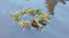 A motley grass wreath floating on the water Stock Footage