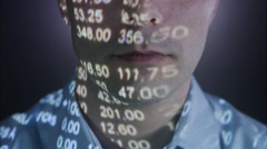A man with the stock-exchange quotation reflected on his face. Stock Footage