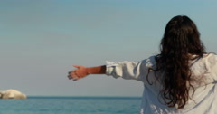Stock Video Footage of Happy woman with arms outstretched at the beach