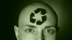 A man with recycling symbol projected on his face. Stock Footage
