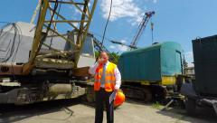 Chief talking in the parking lot of heavy construction equipment. - stock footage