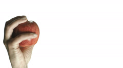SLO MO CU Studio shot of mans hand throwing apple on white background Stock Footage