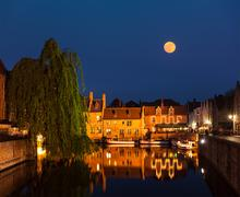 Canal and medieval houses in twilight. Bruges (Brugge), Belgium Stock Photos