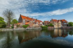 Canal and medieval houses. Bruges (Brugge), Belgium Stock Photos