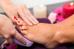 Stock Photo of Woman having a pedicure treatment at a spa