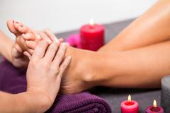 Woman having a pedicure treatment at a spa - stock photo