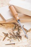 Phillips head screwdriver and wood screws - stock photo