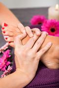 Woman having a pedicure treatment at a spa - stock photo