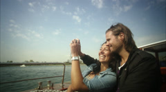 MS POV Young couple taking self portrait in boat / Copenhagen, Denmark, Stock Footage