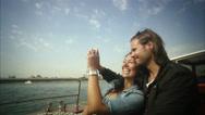 Stock Video Footage of MS POV Young couple taking self portrait in boat / Copenhagen, Denmark,