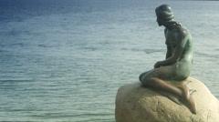 WS View of Little Mermaid statue on rock / Copenhagen, Denmark, Scandinavian Stock Footage