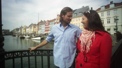 MS PAN Young Couple standing on bridge and talking / Copenhagen, Denmark, Stock Footage