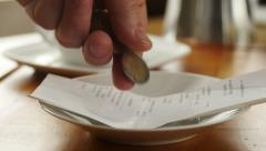 Leaving tip with Euro coins, slow motion - stock footage