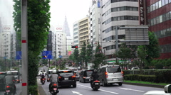 Car Traffic On Busy City Streets In Shinjuku Tokyo - stock footage