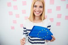 Woman holding Europian flag Stock Photos