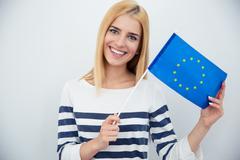 Patriotic woman holding european flag - stock photo