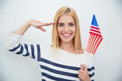 Patriotic woman holding USA flag - stock photo