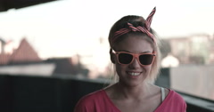 Happy attractive young skate girl smiling in to the camera Stock Footage