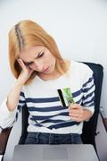 Woman holding bank card - stock photo