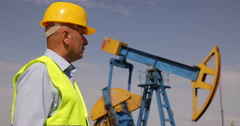 Engineer Looking Oil Field Supervise Extracting Pump Management Experience Job Stock Footage