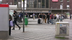 Tram passing infront of Hauptbahnhof train station in Dusseldorf - stock footage