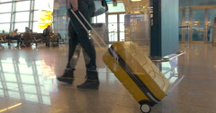Walking with travel bag at the airport Stock Footage