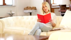 Mature woman reading a red book Stock Footage