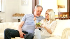 Mature couple eating a salad - stock footage