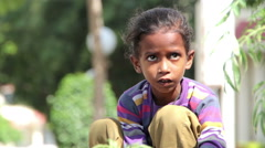Indian girl with mother sits on the city street. Delhi. India. 2015 Stock Footage