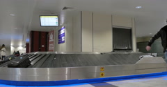 People in baggage claim area of airport Stock Footage